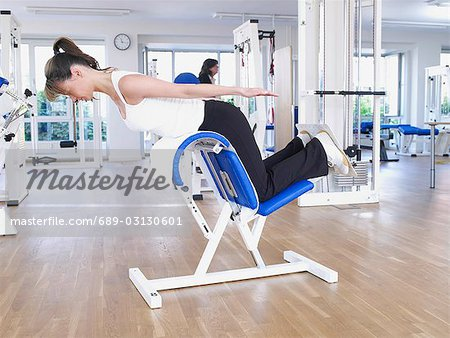 workout at the torso lifter Stock Photo - Premium Royalty-Free, Image code: 689-03130601