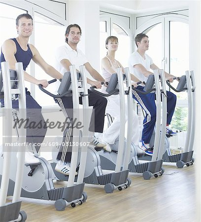 young people on fitness bikes Stock Photo - Premium Royalty-Free, Image code: 689-03130607