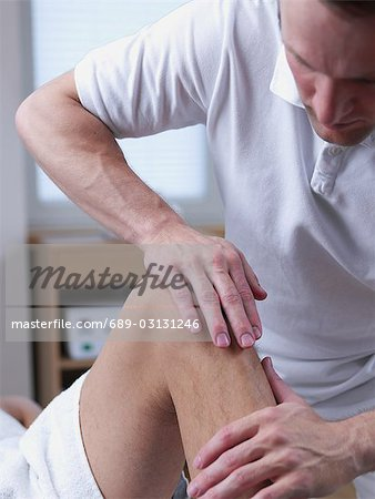 physical therapist Stock Photo - Premium Royalty-Free, Image code: 689-03131246
