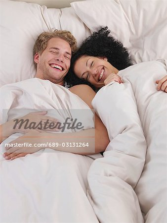 lazy time in bed Stock Photo - Premium Royalty-Free, Image code: 689-03131264