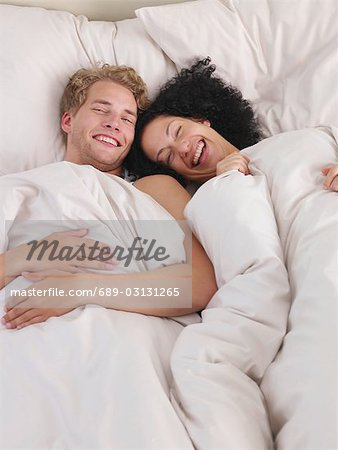 young couple in bed Stock Photo - Premium Royalty-Free, Image code: 689-03131265