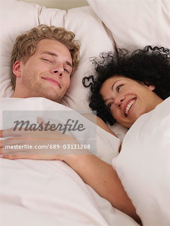 young couple in bed Stock Photo - Premium Royalty-Free, Image code: 689-03131268