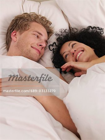 young couple in bed Stock Photo - Premium Royalty-Free, Image code: 689-03131270