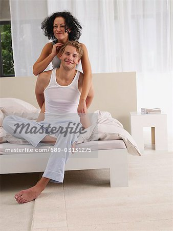 young couple in bed Stock Photo - Premium Royalty-Free, Image code: 689-03131275