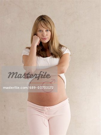 Pregnant woman with male symbol on stomach Stock Photo - Premium Royalty-Free, Image code: 689-03733172