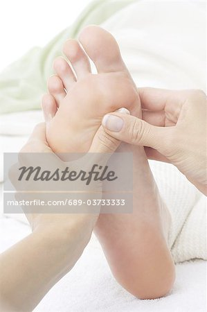 Foot zone massage Stock Photo - Premium Royalty-Free, Image code: 689-03733333