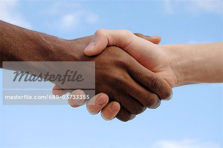 Two men shaking hands Stock Photo - Premium Royalty-Free, Image code: 689-03733355