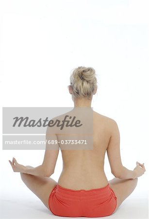 Backless woman in lotus position Stock Photo - Premium Royalty-Free, Image code: 689-03733471