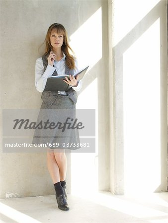 Businesswoman holding scheduler Stock Photo - Premium Royalty-Free, Image code: 689-03733681