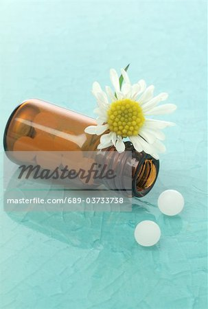 Globules in medicine bottle Stock Photo - Premium Royalty-Free, Image code: 689-03733738