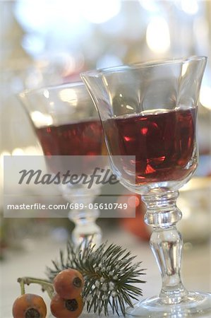 Two glasses of red wine and twig with fruits Stock Photo - Premium Royalty-Free, Image code: 689-05610749