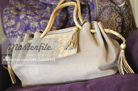 Handbag on couch Stock Photo - Premium Royalty-Free, Image code: 689-05610915