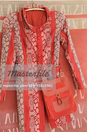 Coat and shoulder bag on coat hanger Stock Photo - Premium Royalty-Free, Image code: 689-05610961