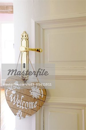 Welcome sign at door knob