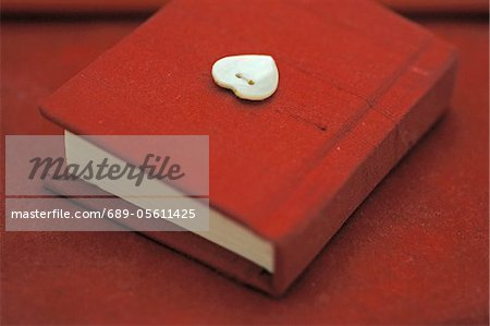 Red diary Stock Photo - Premium Royalty-Free, Image code: 689-05611425