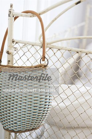 Handbag hanging at bedpost Stock Photo - Premium Royalty-Free, Image code: 689-05611466