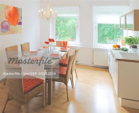 Dining room with painting on the wall Stock Photo - Premium Royalty-Free, Image code: 689-05611504