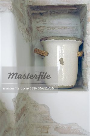 Earthenware jug in a niche Stock Photo - Premium Royalty-Free, Image code: 689-05611756