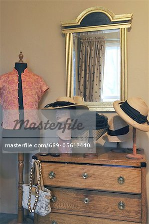 Ladieswear at dresser with mirror Stock Photo - Premium Royalty-Free, Image code: 689-05612440