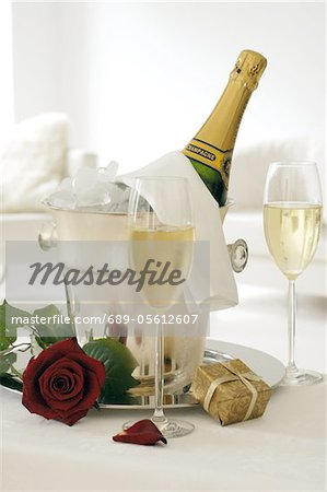 Champagne in ice bucket and red rose Stock Photo - Premium Royalty-Free, Image code: 689-05612607
