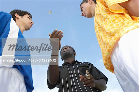 Flipping a Coin Before the Game Stock Photo - Premium Royalty-Free, Image code: 693-03299632