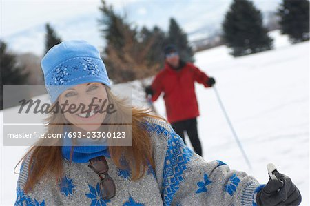 Portrait of smiling mature woman cross country skiing Stock Photo - Premium Royalty-Free, Image code: 693-03300123