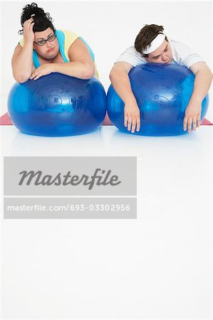 Overweight Man and Woman with Exercise Balls Stock Photo - Premium Royalty-Free, Image code: 693-03302956