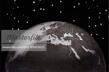 Globe against starry sky, cropped Stock Photo - Premium Royalty-Free, Image code: 693-03303023