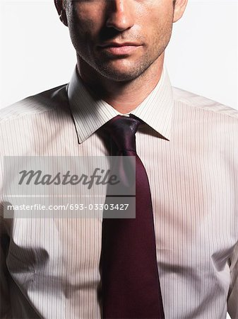 Sweaty Young Businessman, mid section Stock Photo - Premium Royalty-Free, Image code: 693-03303427