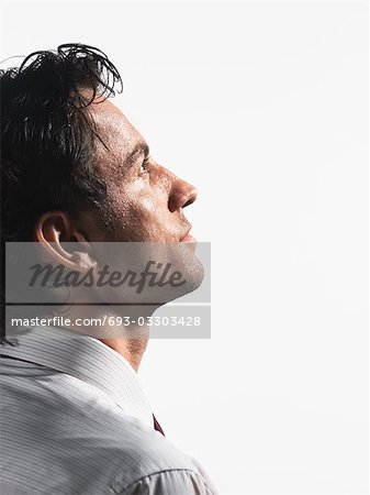 Tired Young Businessman staring into space, profile Stock Photo - Premium Royalty-Free, Image code: 693-03303428