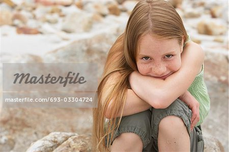 Smiling Girl Outdoors Stock Photo - Premium Royalty-Free, Image code: 693-03304724