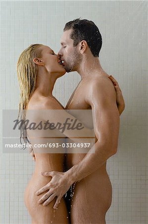 Naked couple embracing in shower Stock Photo - Premium Royalty-Free, Image code: 693-03304937