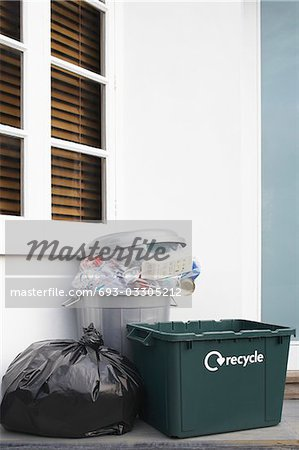 Garbage containers outside building Stock Photo - Premium Royalty-Free, Image code: 693-03305212