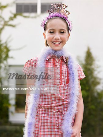 Portrait of girl (10-12) in tiara and feather boa Stock Photo - Premium Royalty-Free, Image code: 693-03305618