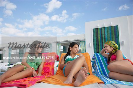 Three teenage girls (16-17) lying on sunloungers Stock Photo - Premium Royalty-Free, Image code: 693-03305793