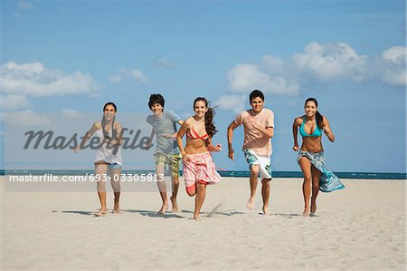 Group of teenagers (16-17) running on beach Stock Photo - Premium Royalty-Free, Image code: 693-03305813
