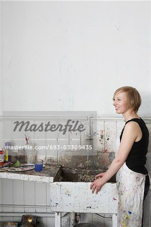 Artist standing by sink in studio Stock Photo - Premium Royalty-Free, Image code: 693-03309435
