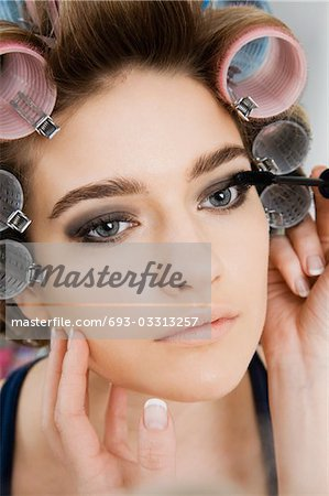 Model in Hair Curlers Having Makeup Applied Stock Photo - Premium Royalty-Free, Image code: 693-03313257