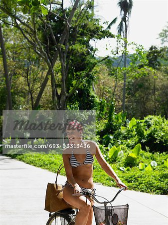 Young Woman Riding a Bike Stock Photo - Premium Royalty-Free, Image code: 693-03313436