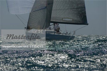 Yacht competes in team sailing event, California Stock Photo - Premium Royalty-Free, Image code: 693-03314260