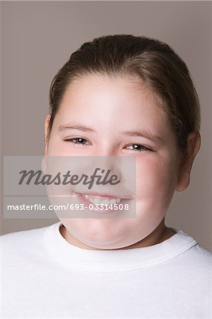 Overweight girl, smiling Stock Photo - Premium Royalty-Free, Image code: 693-03314508