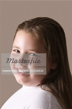 Overweight girl, smiling Stock Photo - Premium Royalty-Free, Image code: 693-03314510