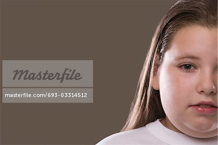 Overweight girl, pensive Stock Photo - Premium Royalty-Free, Image code: 693-03314512