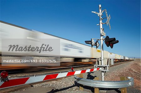 Train passing level crossing, motion blur Stock Photo - Premium Royalty-Free, Image code: 693-03317575