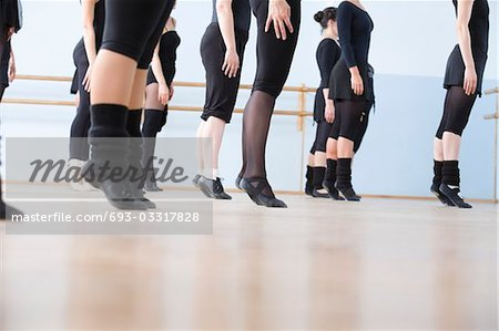 Young women practise ballet in a rehearsal room Stock Photo - Premium Royalty-Free, Image code: 693-03317828