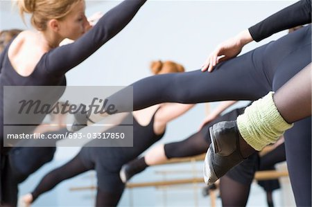 Young women stretch into ballet positions Stock Photo - Premium Royalty-Free, Image code: 693-03317850