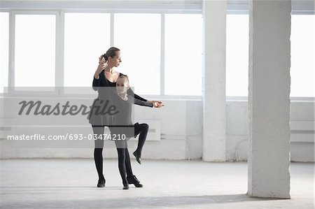 Woman and girl practise dance moves Stock Photo - Premium Royalty-Free, Image code: 693-03474210