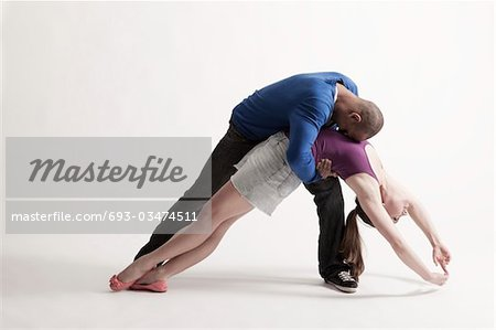 Man holds modern dance partner in position of loss Stock Photo - Premium Royalty-Free, Image code: 693-03474511