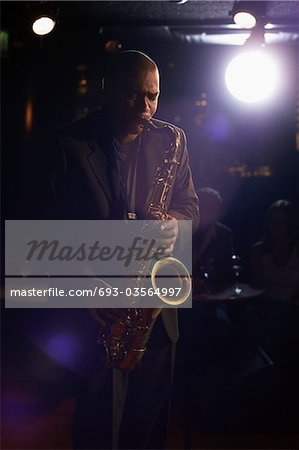 Saxophonist Playing Jazz Stock Photo - Premium Royalty-Free, Image code: 693-03564997