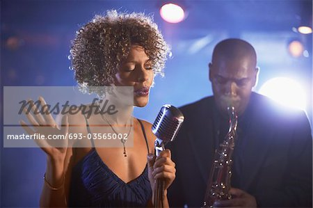Jazz Singer and Saxophonist Performing Stock Photo - Premium Royalty-Free, Image code: 693-03565002